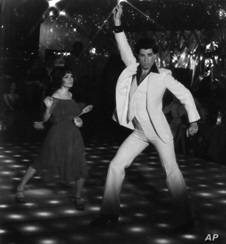 "FILE - John Travolta and Karen Gorney dance in a nightclub scene to disco music in Paramount Pictures' 1977 film ""Saturday Night Fever."""