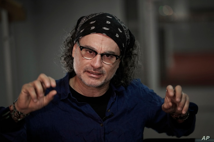 Lebanese director Ziad Doueiri poses during an interview with Associated Press in Paris, France, Jan. 24, 2018.