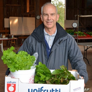 Shareholder Dennis Luther leaves with his weekly supply of fresh, organic vegetables:  beets, turnips, peppers,sweet potatoes and greens.