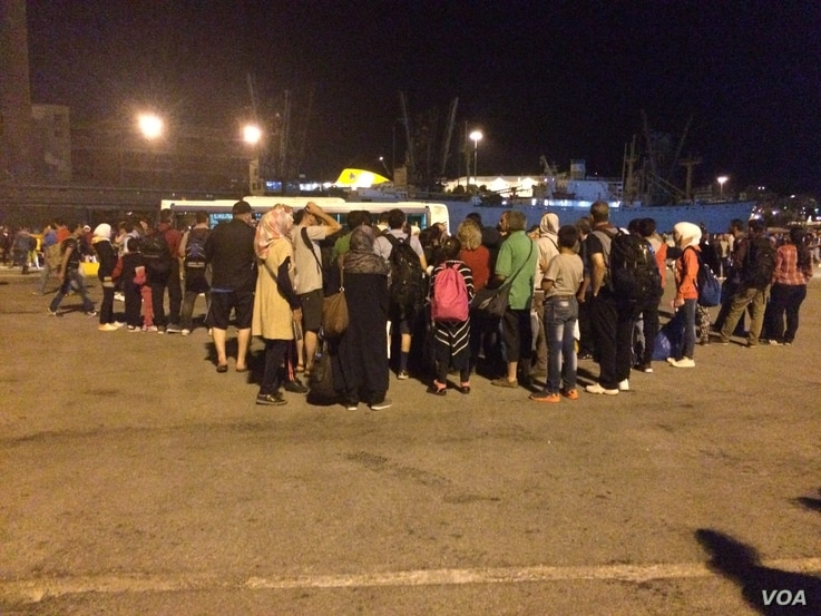 When refugees arrived in Athens on Saturday, they were surprised to find buses ready to race them to the border for a little over $50 each, Sept. 12, 2015.  (Photo: H.Murdock)