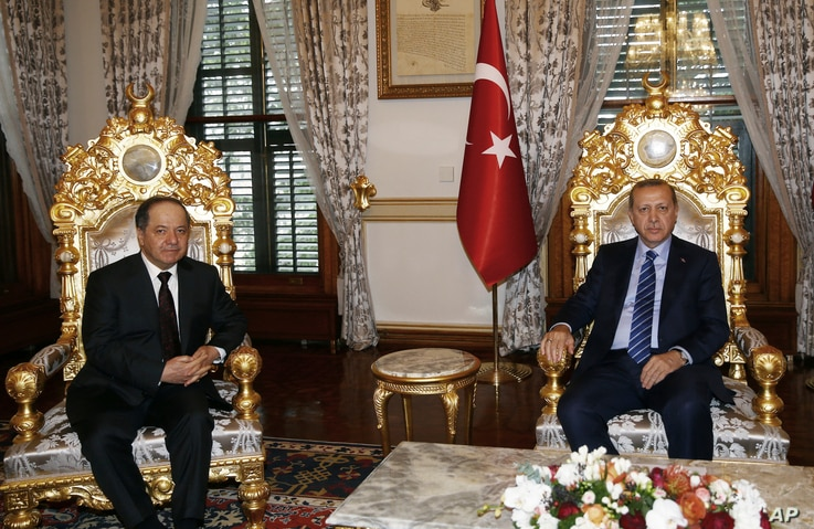 FILE - Turkey's President Recep Tayyip Erdogan, right, and Iraqi Kurdish leader Massoud Barzani are seen prior to their meeting in Istanbul, Feb. 26, 2017. Ankara has been courting Barzani in its fight against the PKK and groups affiliated with it.