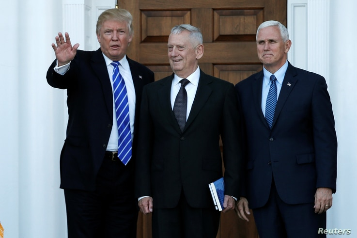 U.S. President-elect Donald Trump and Vice President-elect Mike Pence greet retired Marine General James Mattis for a meeting at the main clubhouse at Trump National Golf Club in Bedminster, New Jersey, November 19, 2016.