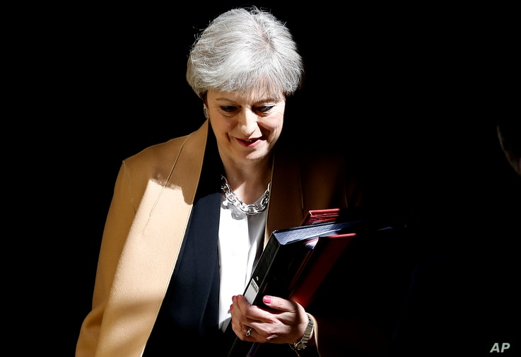 British Prime Minister Theresa May leaves 10 Downing Street in London to take questions at the Houses of Parliament, April 19, 2017.