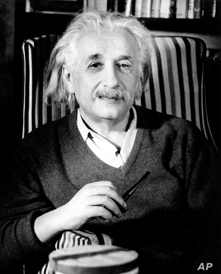 Prof. Albert Einstein is shown a few days before his 70th birthday in his home in Princeton, N.J., in March 1949.