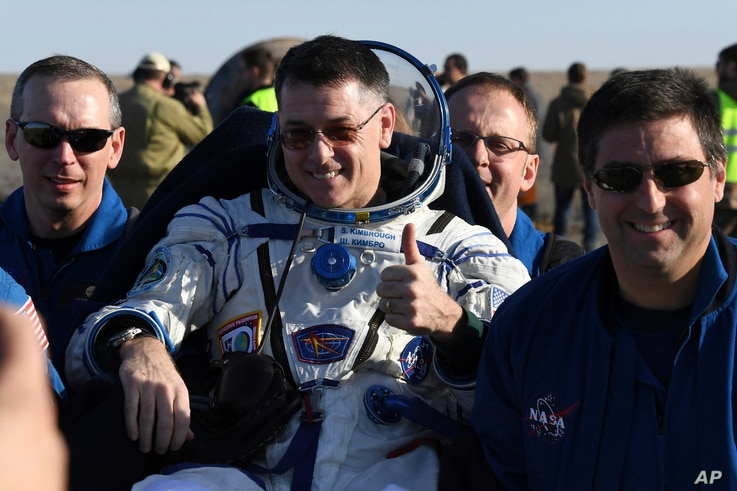 Ground personnel carry US astronaut Robert Shane Kimbrough shortly after Russia's Soyuz MS-02 space capsule carrying three members of the ISS landed near Dzhezkazgan, Kazakhstan, April 10, 2017.