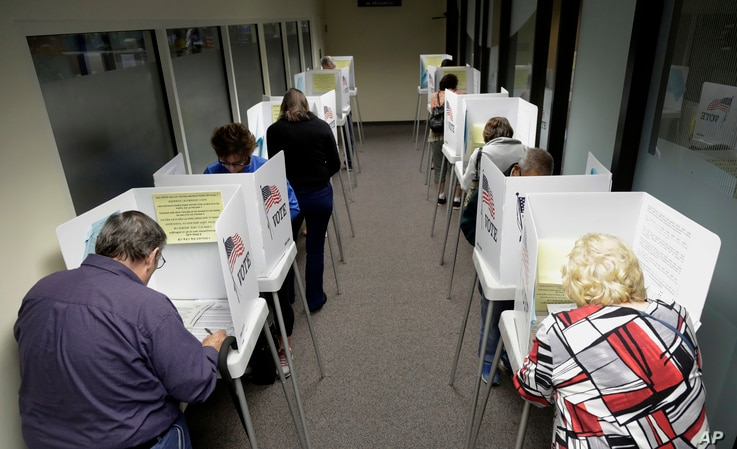 Voters cast ballots at the Santa Clara County Registrar of Voters in San Jose, Calif., Oct. 24, 2016.