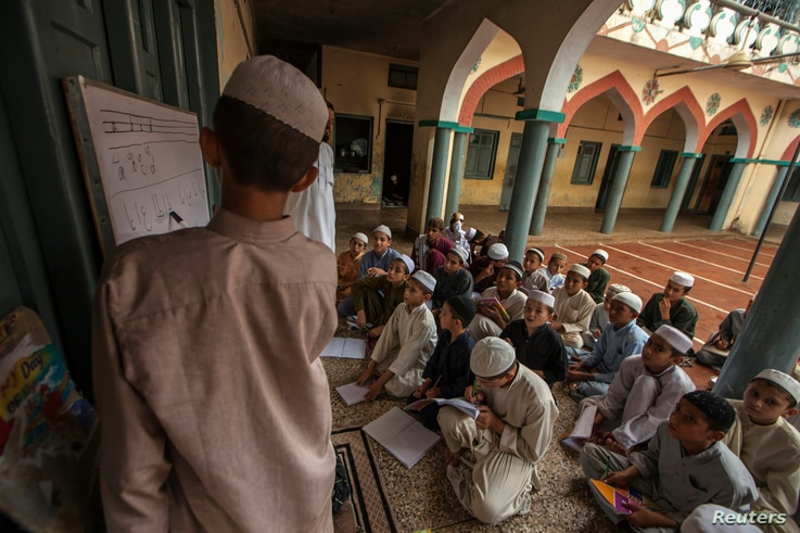 FILE - Pakistani religious students attend a lesson at Darul Uloom Haqqania, an Islamic seminary and alma mater of several Taliban leaders, in Akora Khattak, Khyber Pakhtunkhwa province.