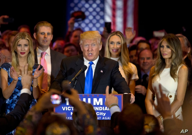 Republican presidential candidate Donald Trump is joined by his wife Melania, right, daughter Ivanka, left, and son Eric, background left, as he speaks during a primary night news conference, May 3, 2016, in New York.