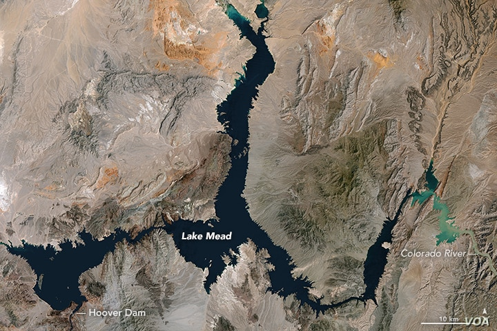 The image shows Lake Mead on the Nevada-Arizona state border at its highest point ever, taken by the Thematic Mapper on the Landsat 5 satellite, May 1984.