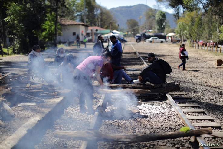 Members of the National Coordination of Education Workers (CNTE) teachers' union block a railway during a protest in Patzcuaro, in Michoacan state, Mexico, Jan. 26, 2019.
