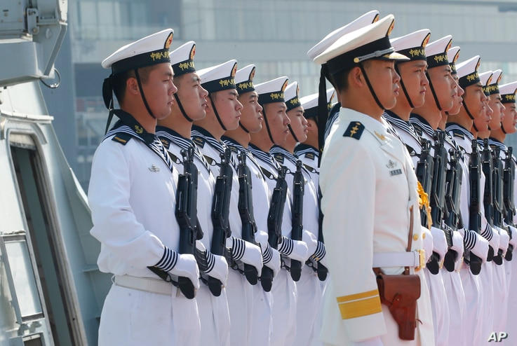 "Chinese People's Liberation Army Navy troops stand in formation on the deck of a type 054A guided missile frigate ""Wuhu"" as it docks at Manila's South Harbor for a four-day port call, Jan. 17, 2019 in Manila, Philippines."