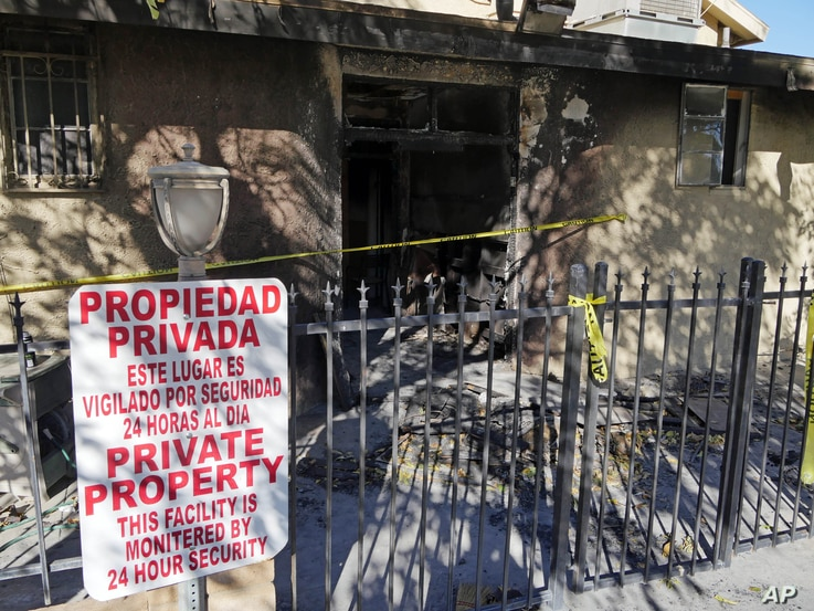 Police tape marks off the burned front lobby of the Islamic Center of Palm Springs in Coachella, Calif., Dec. 12, 2015.