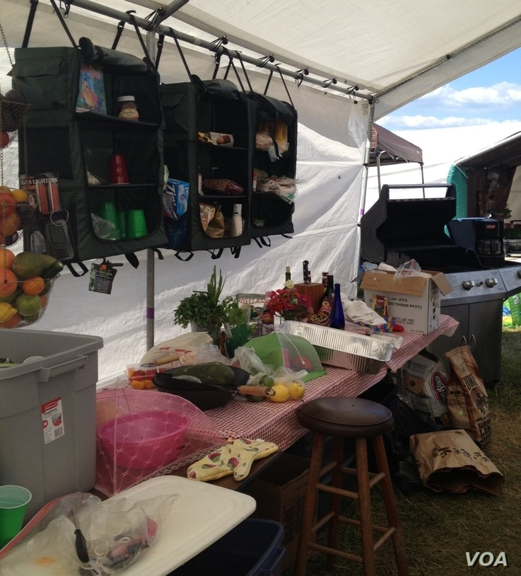 Philadelphia Folk Festival fan Tim, a onetime professional cook who shares a campsite with another former chef, has a full kitchen at his campsite. (VOA/K. Cole)