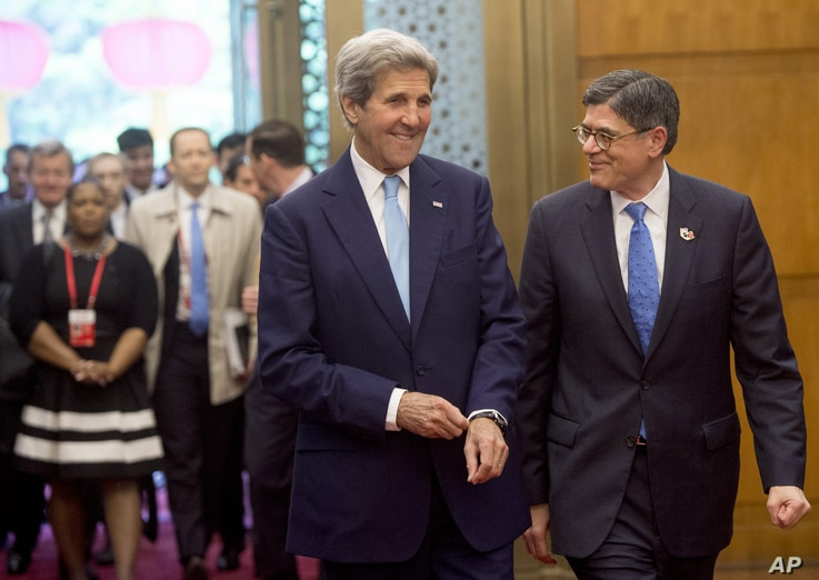 U.S. Secretary of State John Kerry, left, and U.S. Treasury Secretary Jacob Lew arrive for a roundtable breakfast with CEOs during the U.S.-China Strategic and Economic Dialogues at Diaoyutai State Guesthouse in Beijing, June 7, 2016.