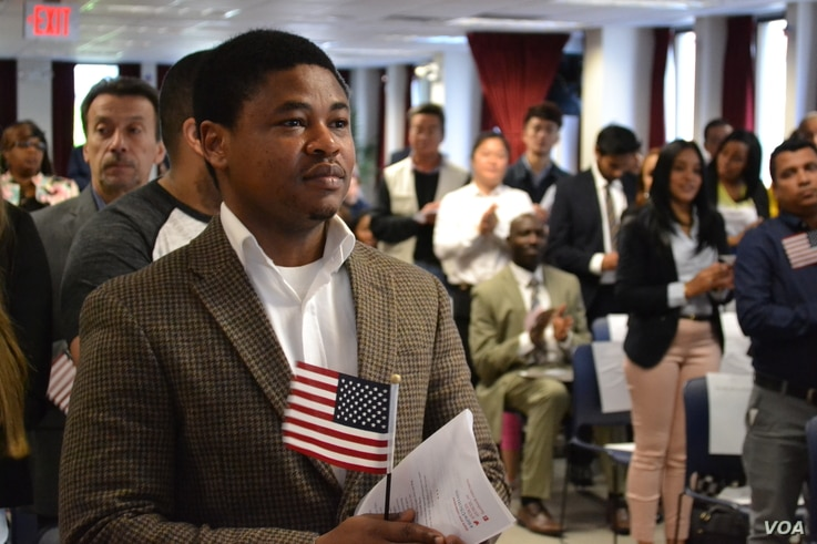 "Chijioke Anyira, from Nigeria, awaits the administration of oath.  ""I hold it in very high esteem to be an American,"" said Anyira, after the ceremony. (R. Taylor/VOA)"