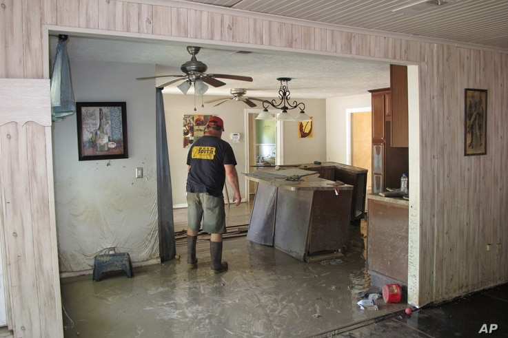 Dwight Chandler walks through his devastated home in Highlands, Texas, Aug. 31, 2017. Chandler, 62, said he worried that Harvey's floodwaters had washed in pollution from a U.S. EPA Superfund site a couple blocks from his home. The Highlands Acid Pit...