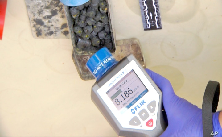 In this April 26, 2016, image made available by Georgia's security service on April 28, 2016, investigators check the radioactivity level of a substance in Tbilisi, Georgia.