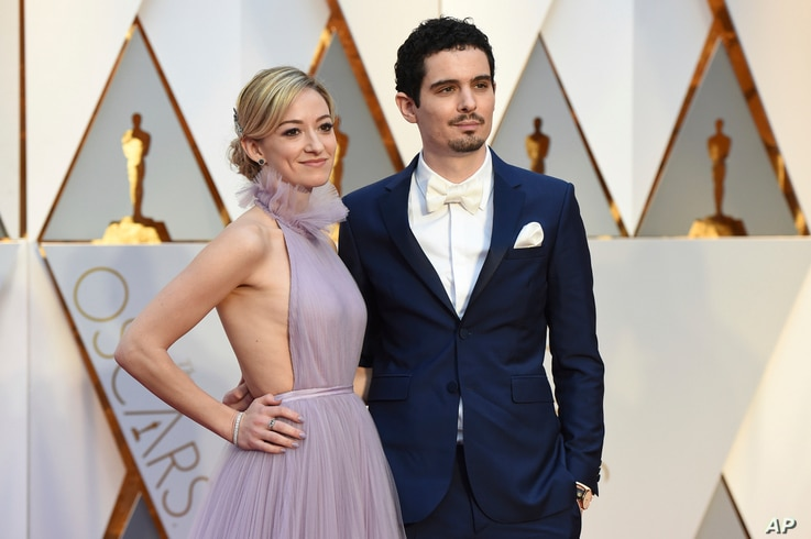 Olivia Hamilton, left, and Damien Chazelle arrive at the Oscars on Sunday, Feb. 26, 2017, at the Dolby Theatre in Los Angeles.