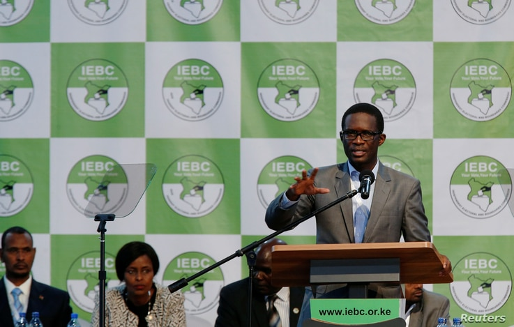 FILE - Chief Electoral Officer of Kenya's Independent Electoral and Boundaries Commission (IEBC) Ezra Chiloba speaks during a news conference ahead of the announcement of the winner of polls in Kenya's election at the Bomas of Kenya, in Nairobi, Keny...