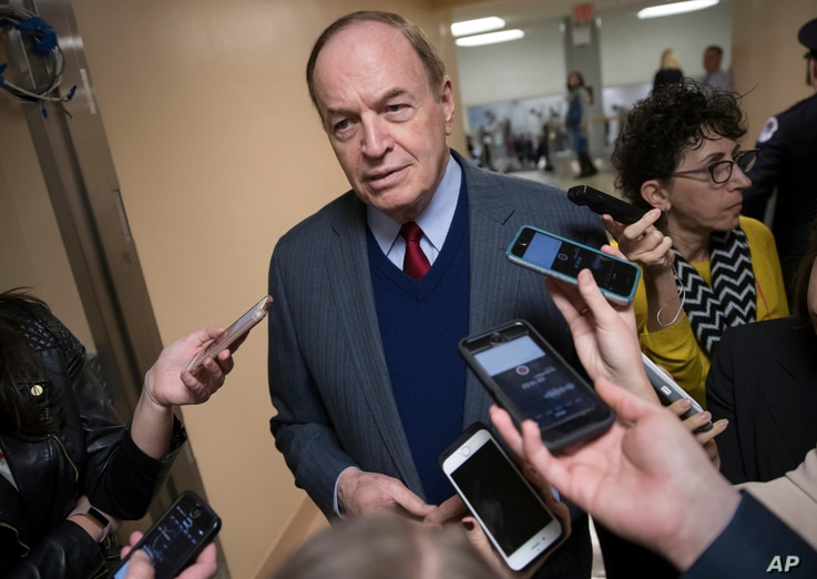 Reporters seek a comment from Sen. Richard Shelby, R-Ala., a critic of Alabama Republican Roy Moore who is running for the Senate in a special election, on Capitol Hill in Washington, Dec. 12, 2017.