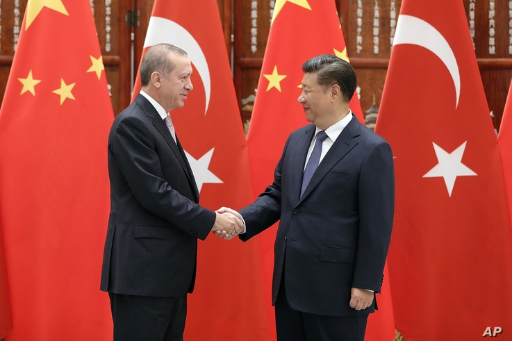 China's President Xi Jinping (R) greets Turkey's President Recep Tayyip Erdogan on the sidelines of a G-20 summit Sept. 3, 2016 in Hangzhou, China. Erdogan is expected to urge world leaders at the meeting to put terrorism high on its agenda.