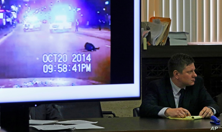A police vehicle dash cam video of the moments after Laquan McDonald was fatally shot is displayed for jurors as Chicago police Officer Jason Van Dyke attends his first-degree murder trial for the shooting death of McDonald, at the Leighton Criminal ...