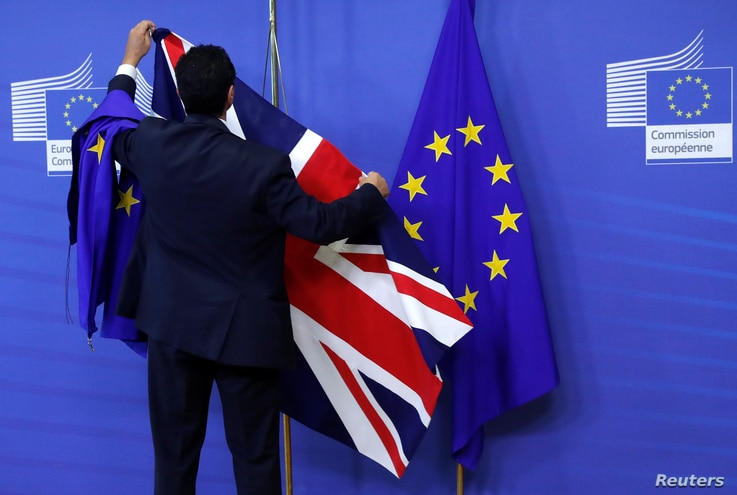 Flags are arranged at the EU Commission headquarters ahead of a first full round of talks on Brexit, Britain's divorce terms from the European Union, in Brussels, Belgium, July 17, 2017.