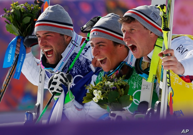 Men's ski cross gold medalist Jean Frederic Chapuis of France, center, celebrates with silver medalist Arnaud Bovolenta of France, left, and bronze medalist Jonathan Midol of France, at the Rosa Khutor Extreme Park, at the 2014 Winter Olympics, Thurs...