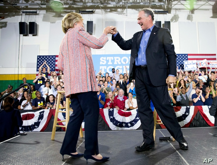 Democratic presidential candidate Hillary Clinton fist bumps Sen. Tim Kaine, D-Va., after speaking at a rally at Northern Virginia Community College in Annandale, Thursday, July 14, 2016. (AP)
