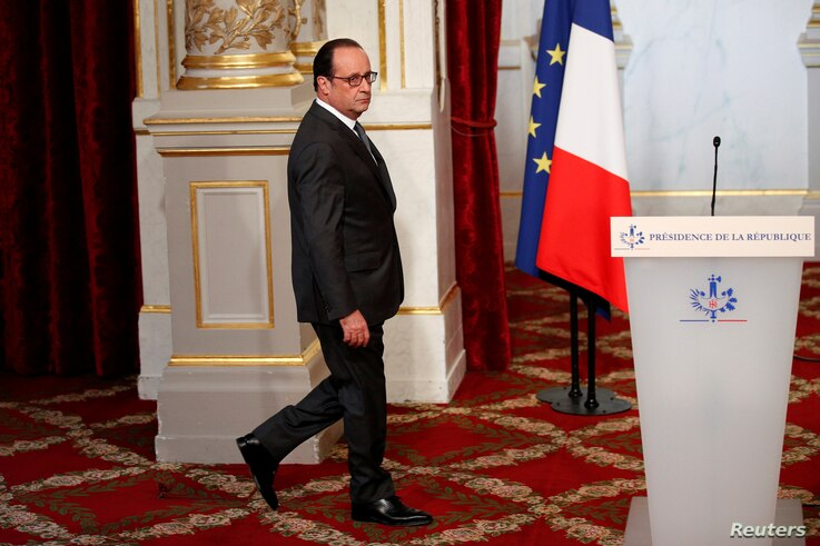 French President Francois Hollande walks to deliver a statement on U.S. election results at the Elysee Palace in Paris, Nov. 9, 2016.