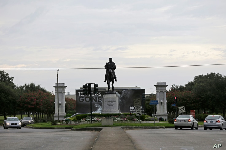 FILE - A statue of P.G.T. Beauregard is seen at the entrance to City Park at Esplanade Ave. in New Orleans, Sept. 2, 2015.