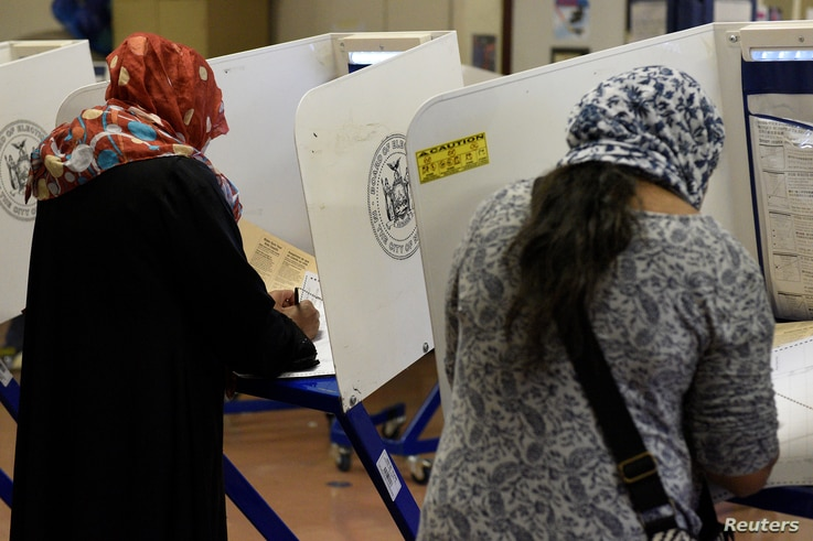 Muslim Bangladeshi Americans vote for the U.S. presidential election in the Queens borough of New York, Nov. 8, 2016.