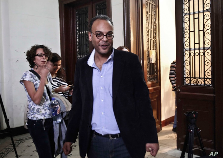 Leading investigative journalist and human rights advocate, Hossam Bahgat is greeted by colleagues and friends in his office at the Egyptian Initiative for Personal Rights in Garden City, Cairo, Egypt, Tuesday, Nov. 10, 2015.