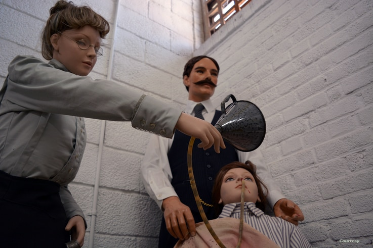 Wax statues at at the Occoquan Workhouse Museum in Lorton, Virginia, show the 1917 force-feeding of suffragist Lucy Burns, an American women's rights advocate who was on hunger strike. (Photo by Diaa Bekheet)