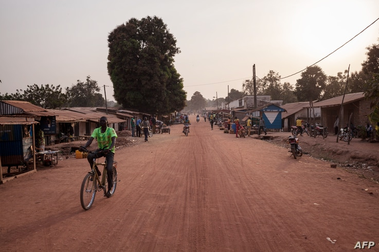 FILE - A man rides a bike in the main avenue of the town of Paoua, northwestern Central African Republic, Dec. 27, 2017.