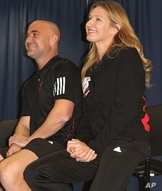Andre Agassi and wife Steffi Graf look on during HIV/AIDS fundraiser auction