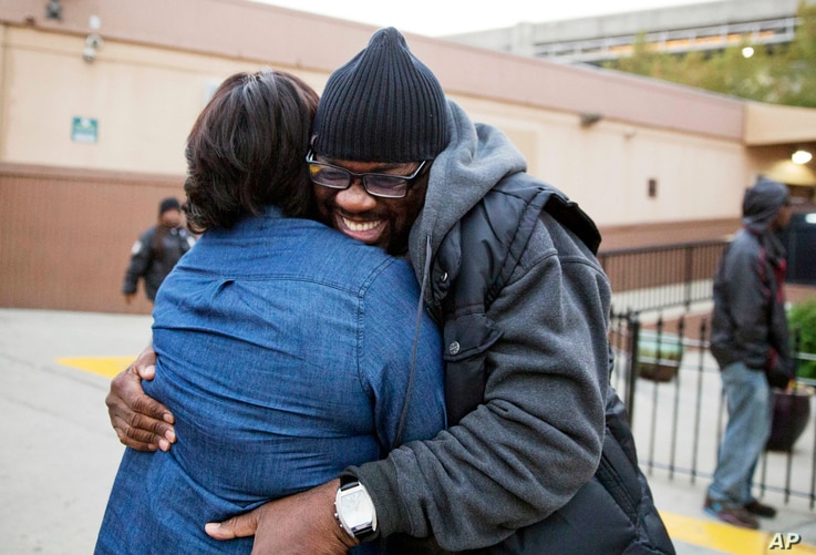 Darryl Hamlett embraces his fiancee, Beverly Conners, as he arrives off a bus from New York to spend the Thanksgiving holiday in Atlanta, Nov. 23, 2016.