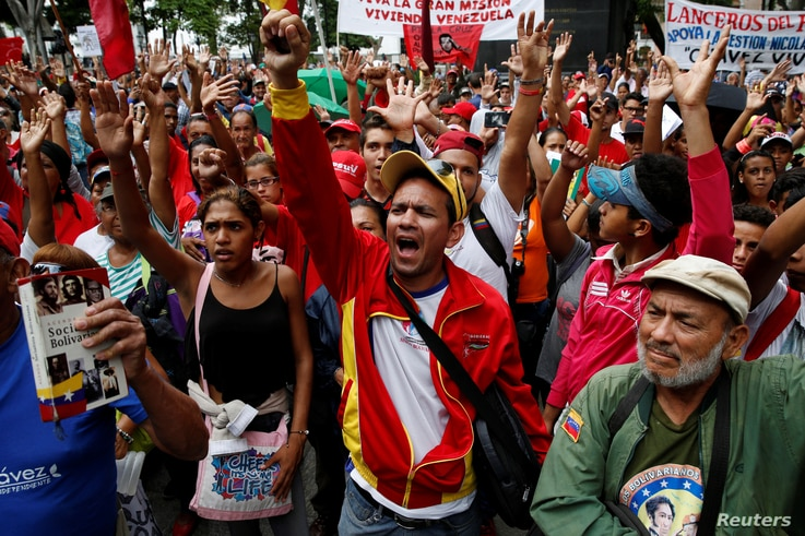 Supporters of Venezuela's President Nicolas Maduro shout as they attend a rally against the application of Organization of American States (OAS) democratic charter, in Caracas, Venezuela, June 23, 2016.