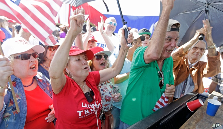 Cuban-American supporters celebrate in the Little Havana area in Miami, as they watch a televised broadcast as President-elect Donald Trump is sworn in as the 45th president of the United States, Friday, Jan. 20, 2017.