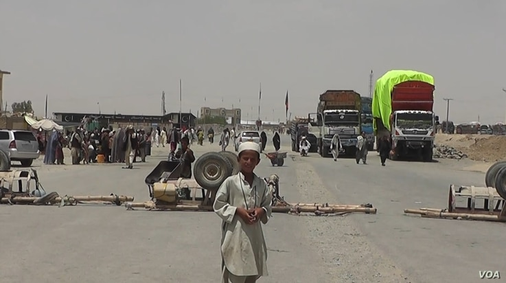 A boy stands at the closed Chaman border crossing between Pakistan and Afghanistan with trucks seen stranded in the background. Pakistan closed its two main border crossings with Afghanistan in response to this Thursday's terror attack in a remote to...