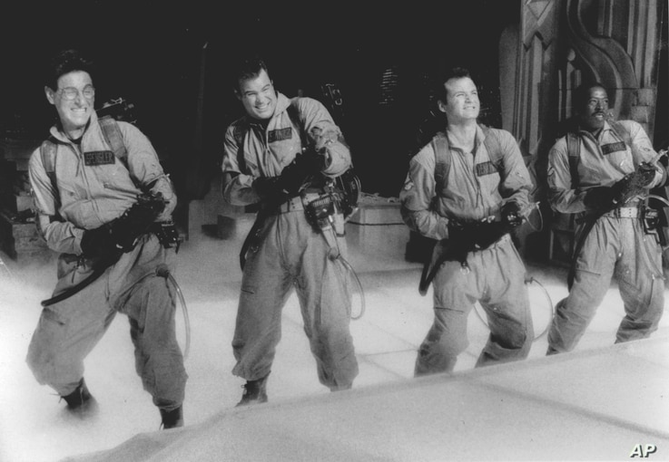 """In this photo provided by Columbia Pictures via the Library of Congress, Harold Ramis, Dan Aykroyd, Bill Murray and Ernie Hudson (left to right) are shown in """"Ghostbusters."""""""