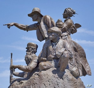 """Herb Mignery's bronze statue, """"Journey West,"""" downtown relives the days when St. Joseph was the last significant American settlement between the Missouri River and California.  Settlement expeditions left from there throughout the 19th century"""