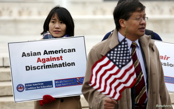 FILE - Asian-American demonstrators hold a rally outside the U.S. Supreme Court as it was hearing a case involving affirmative action in university admissions, Dec. 9, 2015. The case was brought white applicant Abigail Fisher, who claimed that a Univ...