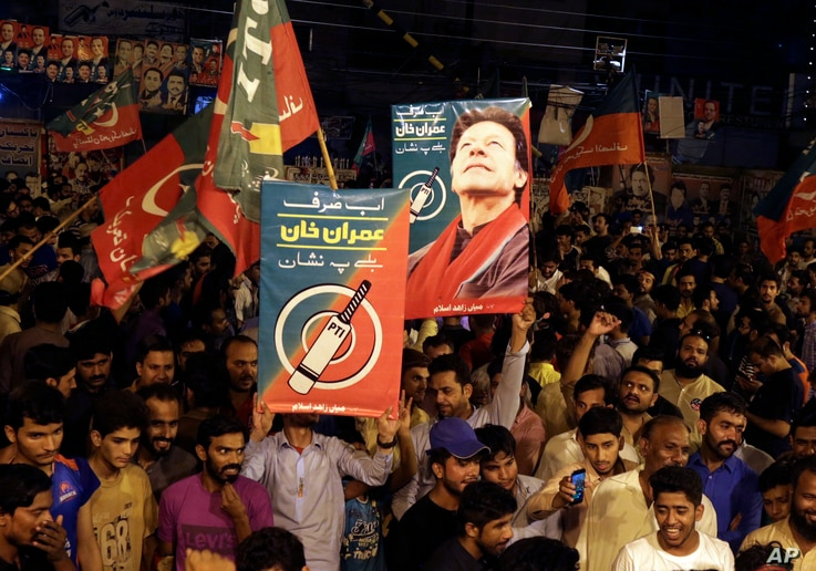 Supporters of Pakistani politician Imran Khan, chief of Pakistan Tehreek-e-Insaf party, celebrate projected unofficial results indicating their candidates' success in the parliamentary elections in Islamabad, Pakistan, July 25, 2018.