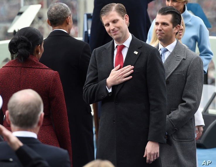 Eric Trump, center, and Donald Trump, Jr., attend the presidential inauguration of their father Donald Trump on Capitol Hill in Washington, Jan. 20, 2017.