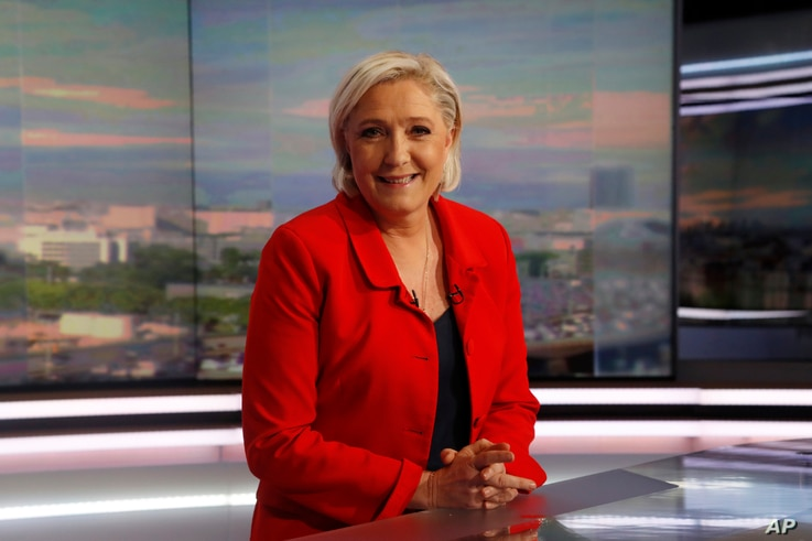 Former French presidential election candidate for the far-right Front National party Marine Le Pen poses prior to an interview on the evening news broadcast of French TV channel TF1, May 18, 2017, in Boulogne-Billancourt, near Paris.