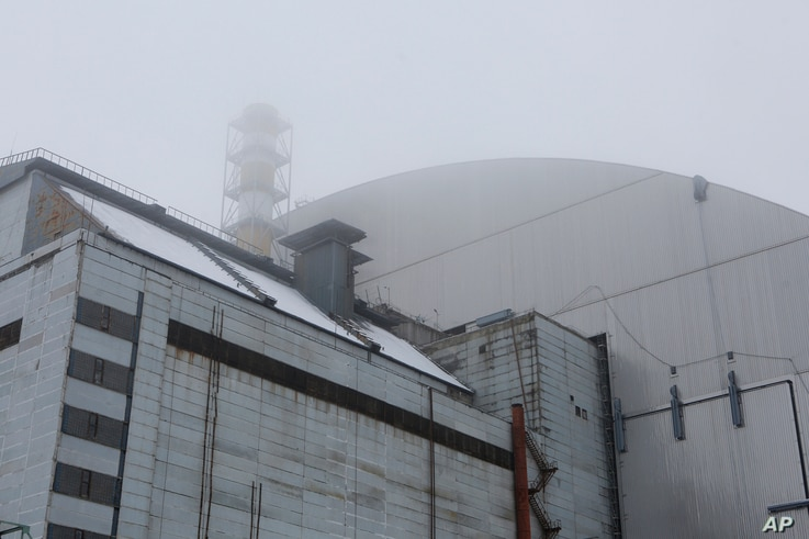 A view of the new shelter installed over the the exploded reactor at the Chernobyl nuclear plant in Chernobyl, Ukraine, Dec. 22, 2016.