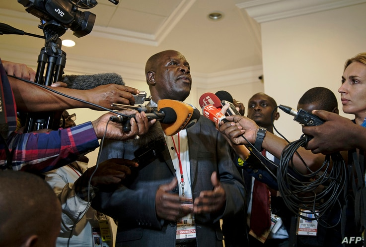 FILE - Ugandan government spokesman Ofwono Opondo speaks to journalists in Entebbe, Nov.11, 2013.
