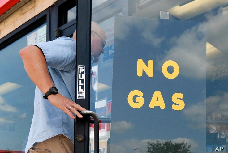 """A customer walks into an Exxon filling station and convenience store location where a sign on the door reads, """"No Gas,"""" Aug. 31, 2017, in Bedford, Texas. It's getting harder to fill gas tanks in parts of Texas where some stations are out of fuel an..."""