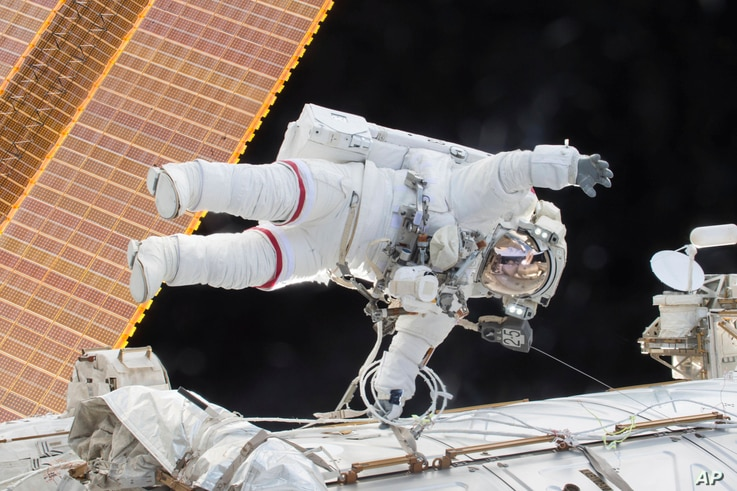 FILE - In this Dec. 21, 2015, photo provided by NASA, Expedition 46 Commander Scott Kelly participates in a spacewalk outside the International Space Station.
